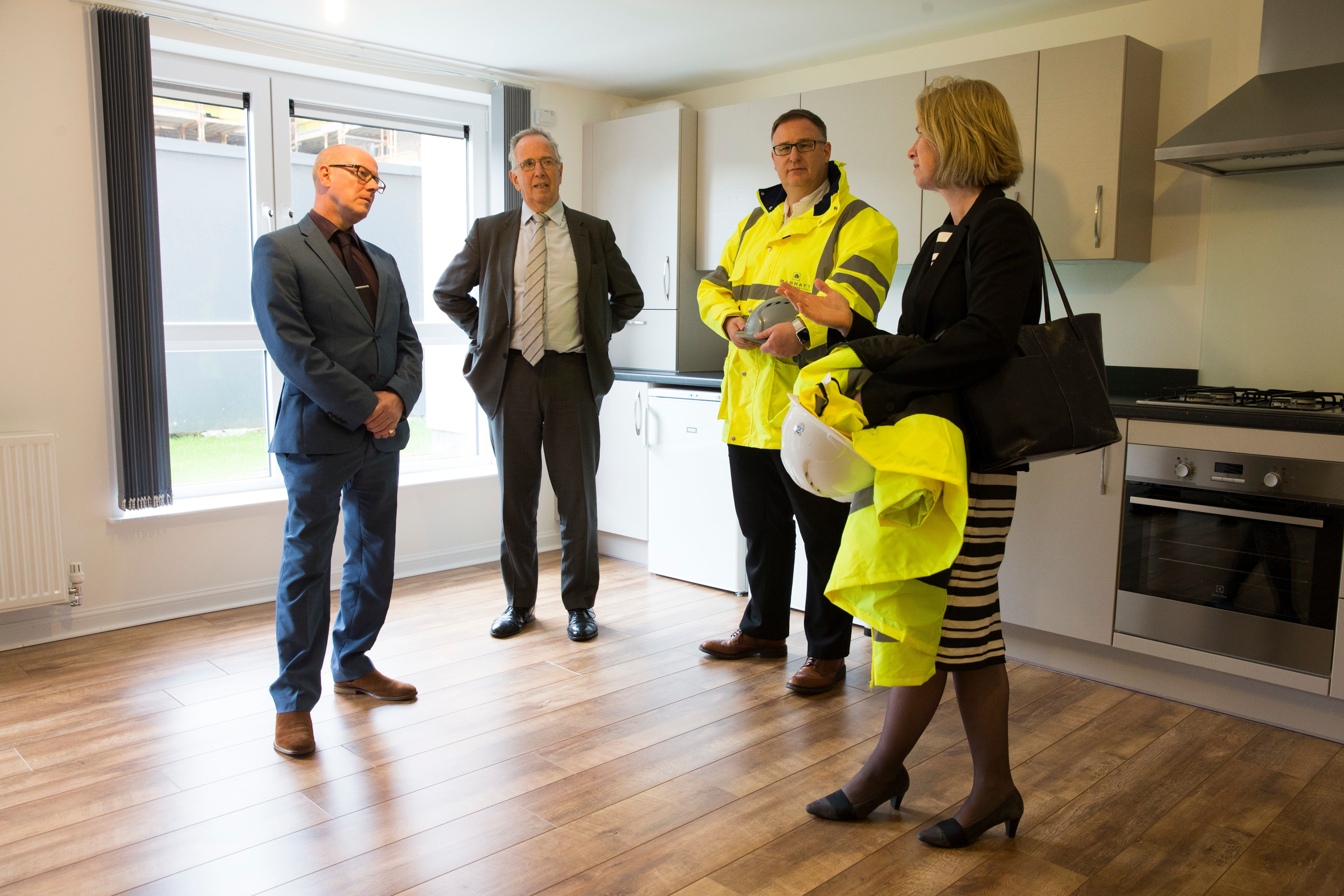 Ocean Apartments, Aberdeen-Aug 17- Gov Minister K Stewart in discussion with LAR's Ann Leslie